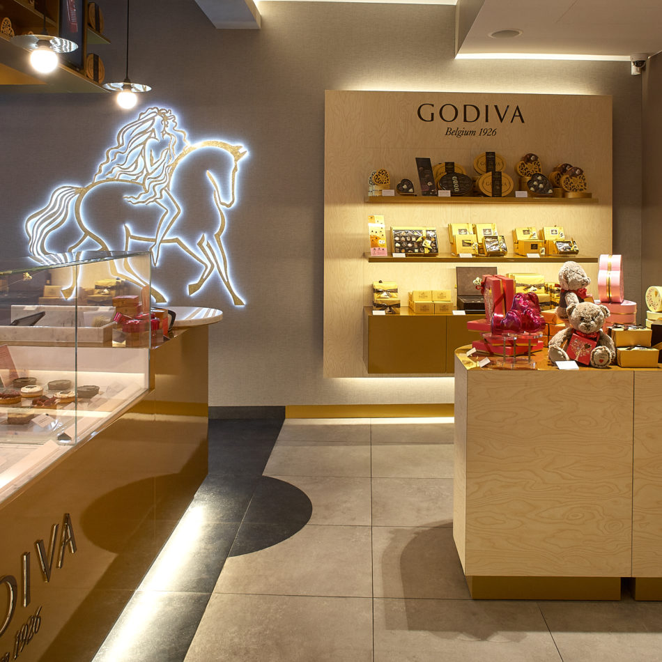 inrichting chocolaterie godiva koeltoonbank goud hilton brussel integral