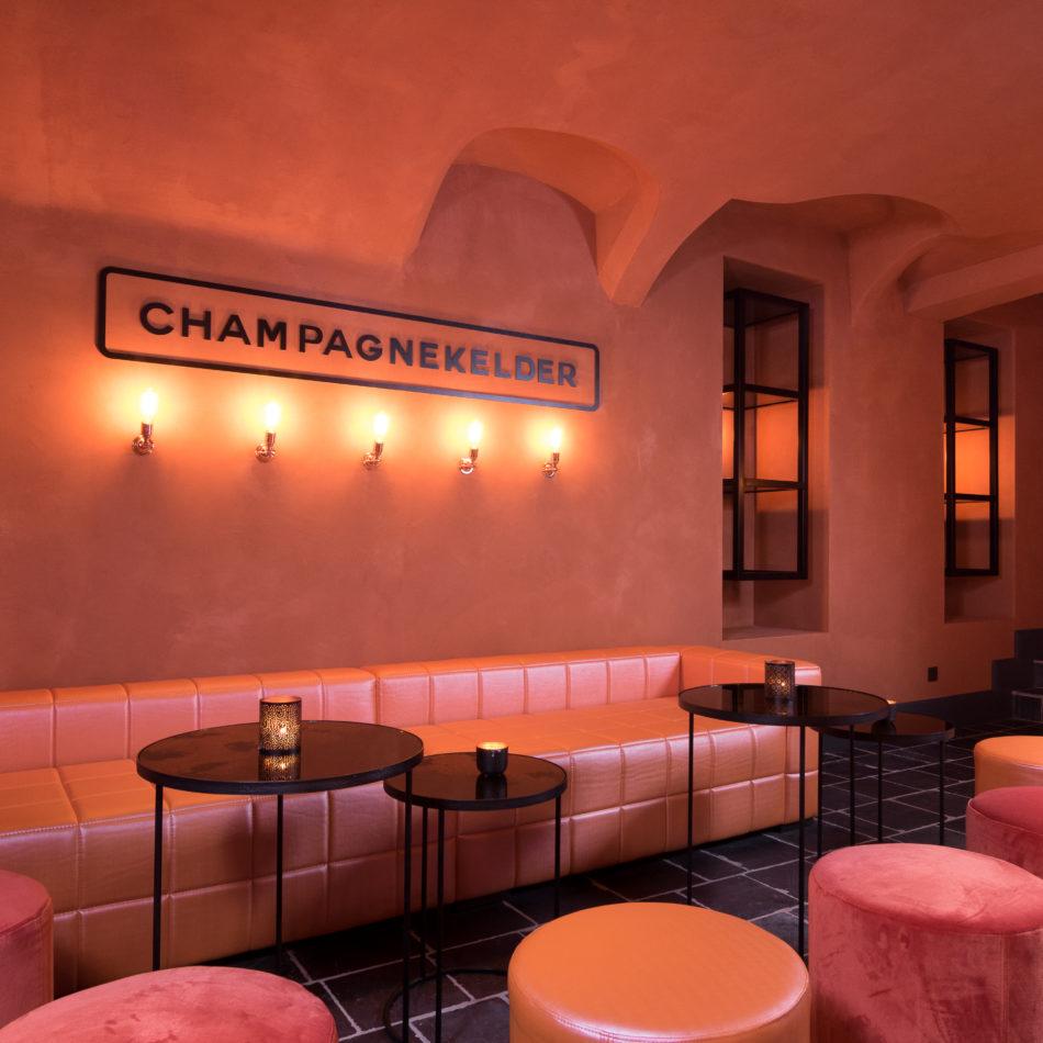 inrichting champagnekelder bar champagne roze koper staal kelder gezellig gent integral